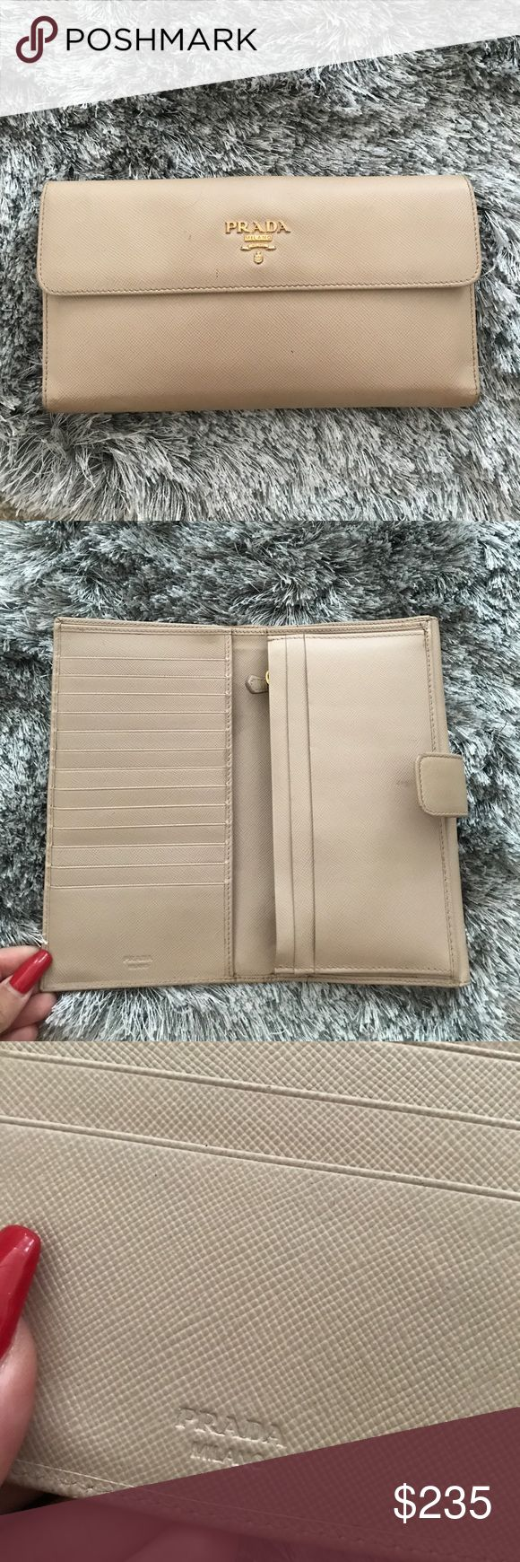 Prada wallet Whole wallet is still in very good condition except that one of the corner the leather has tanned I think from sitting. I haven't used the wallet in a while - $150 through ven. Price is firm Prada Bags Wallets