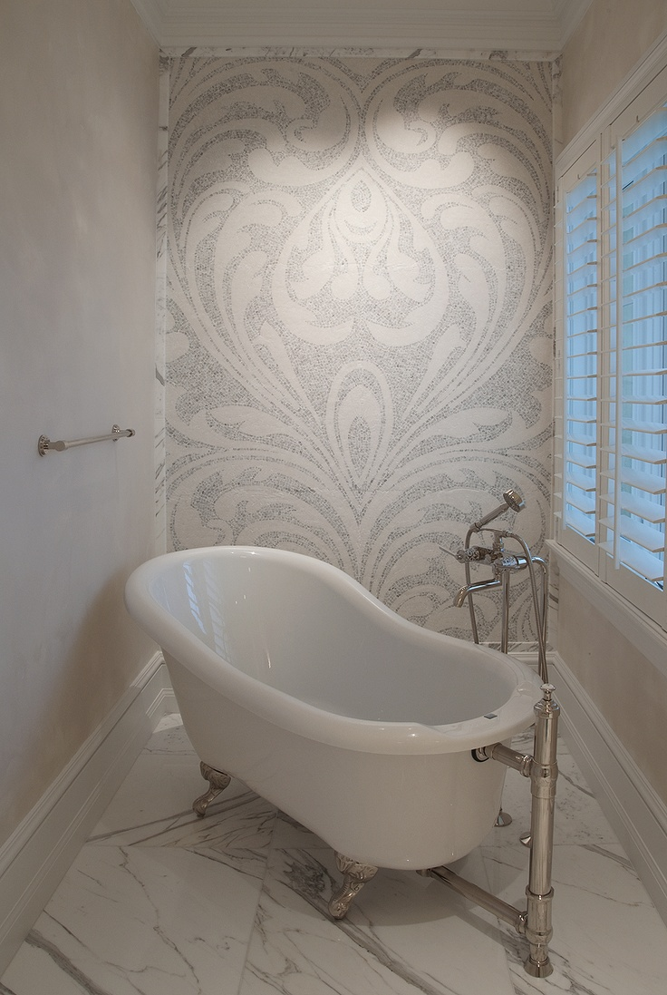 Footed tubs and ornate mosaic tiles all used in that 1920's era.