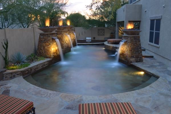 swimming pool with fire bowls pools cabanas