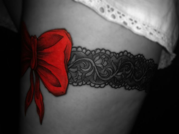 black and white lace garter tattoo with a red bow (http://talklefthanded.wordpress.com)