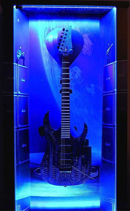 "ZAAX wall guitar display ""Concert For The Aliens"" and Ibanez Giger"