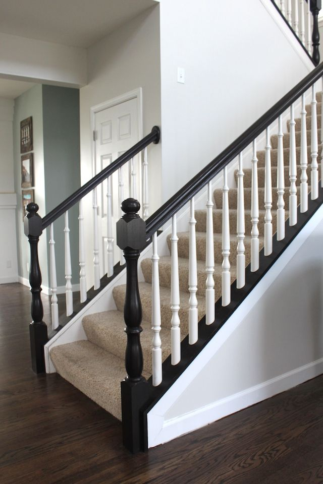 Like me on Facebook - stay up to date with my latests crafts and giveaways!  When we moved in we knew we wanted to finish the wood floors on the 1st  floor (I'll talk a little more about the floors in a later post), but the  new floor color effected the banister color. I wanted to paint it because  the floors were stained a little darker. I had read on a few blogs you can  paint a banister with little prep work. So I gave it a try, and although  there was a lot of work, it was quite easy…