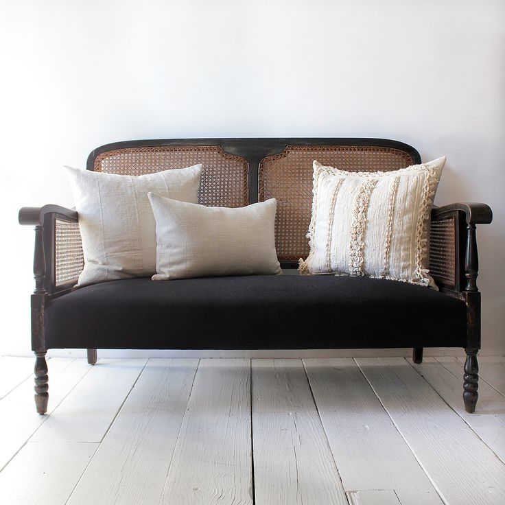 Italian cane sofa and vintage textile pillows at Nickey Kehoe. I was thinking of painting mine black, but that looks too dark here.