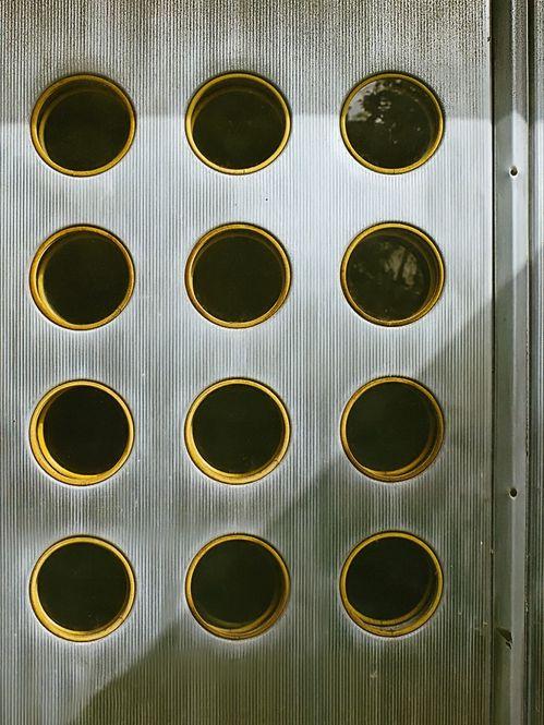 An aluminium door by Jean Prouvé, late 1940s, France. / Elle Decor 2011