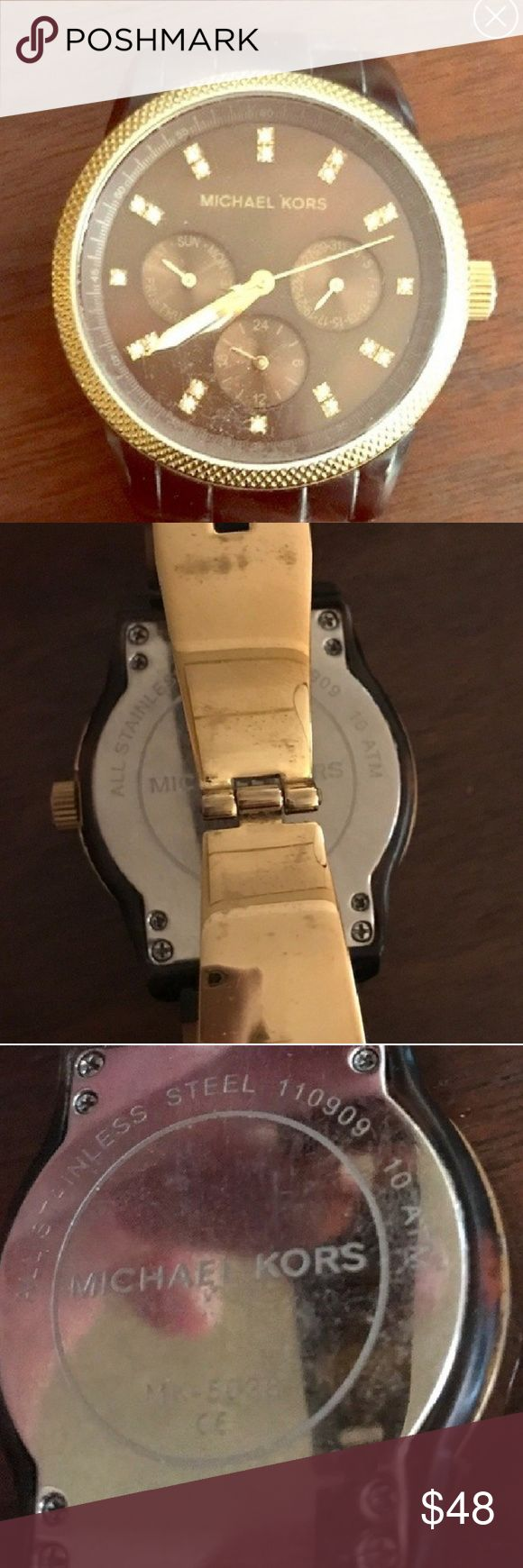 Authentic Michael Kors Watch Authentic Michael Kors Chronograph Watch with tortoise links n gold trim around the face. This watch has been well used and shows it. Batteries were replaced within the last six months and is running. Comes with links, care manual and box. Michael Kors Accessories Watches