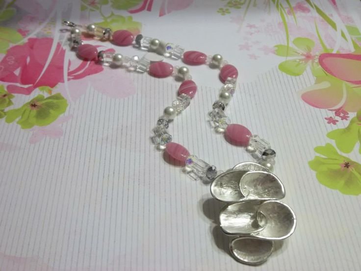 This pretty pink necklace will add a soft touch of glam to your work outfit