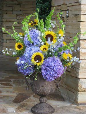 sunflower and hydrangia centerpeice | Ceremony arrangements of bluish/purple hydrangeas, sunflowers, light ...