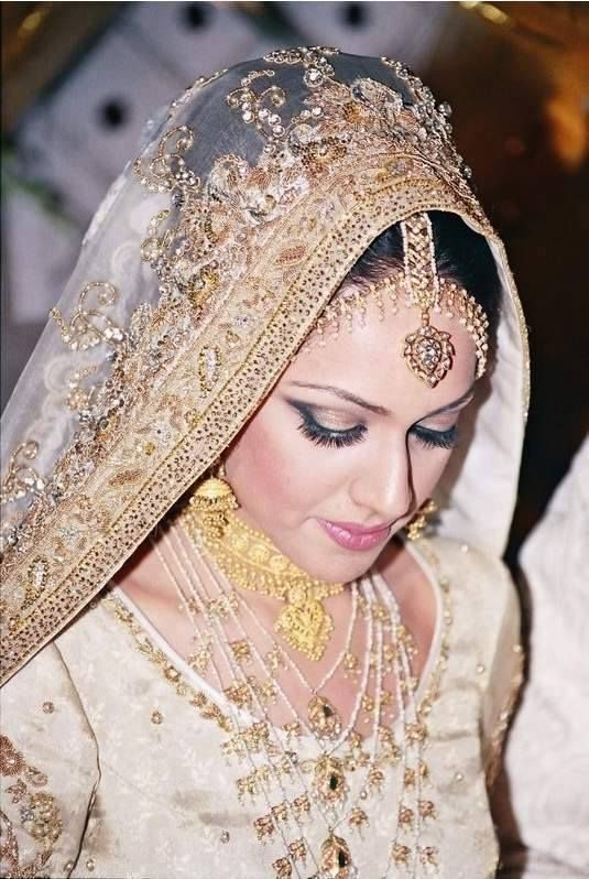desi bride in a white and gold outfit