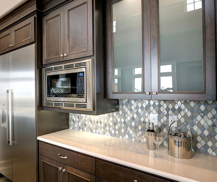 Gorgeous Blues In The Tiled Backsplash   Pairs Well With The Dark Stained  Kitchen Cabinets And