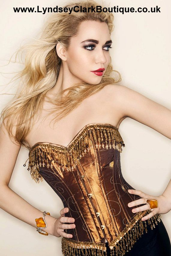 Hey, I found this really awesome Etsy listing at https://www.etsy.com/listing/80391574/steampunk-corset-burlesque-bronze-gold