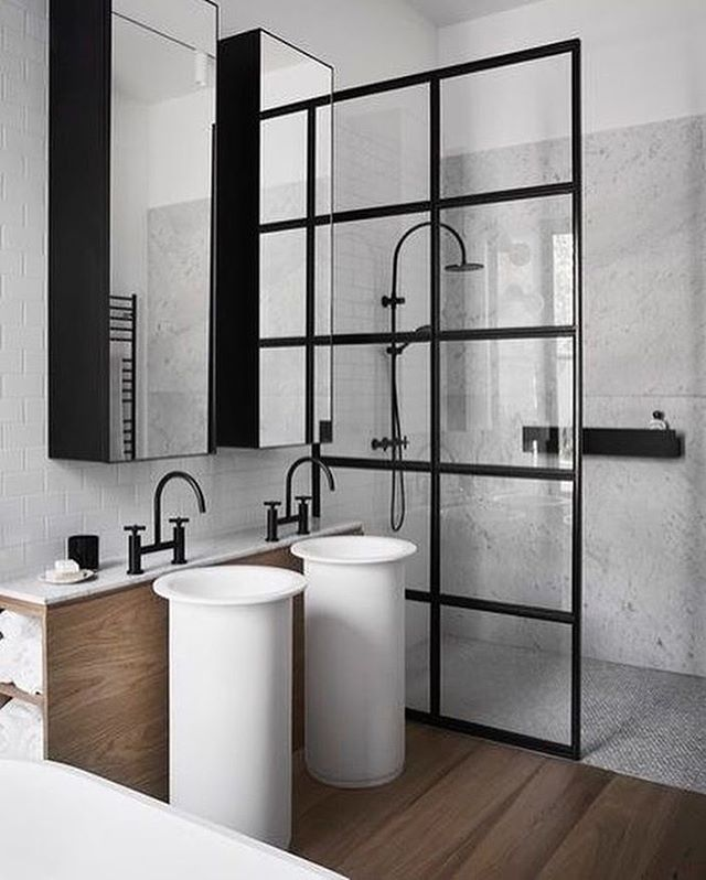 IS TO ME   Love this gorgeous bathroom! Great idea to use the black framed glass partition