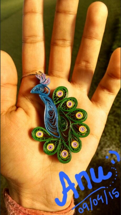 First peacock pendant