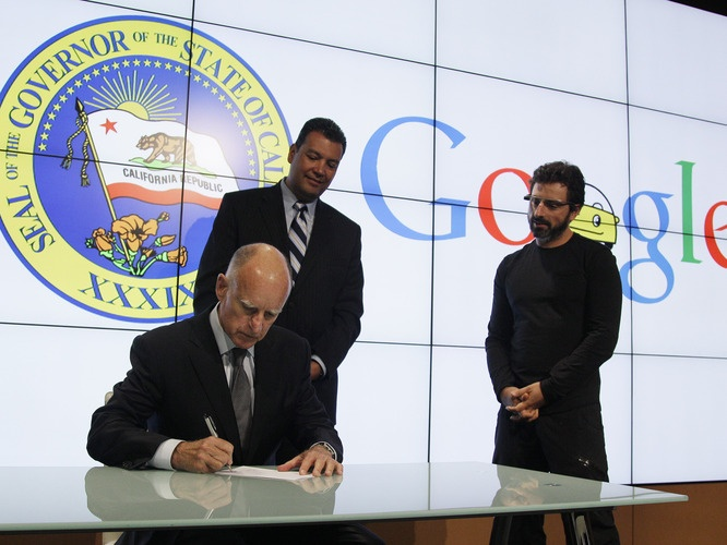 California Gov. Jerry Brown signs a bill for driverless cars as state Sen. Alex Padilla and Google co-founder Sergey Brin look on. The legislation opens the way for driverless cars in the state paving the way to ending traffic accidents and  global Carmageddon. Check out the video of the Car Test and the Morning Edition story on npr. by Steve Henn, npr. #Cars #Self_Driving_Cars #Google #Jerry_Brown #npr #Steve_Henn