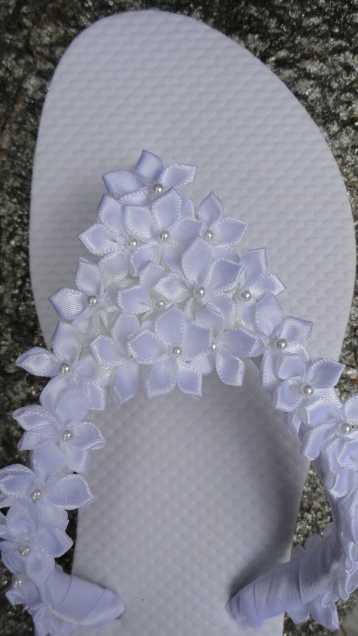 Real or fake flowers? We'll never tell. #wedding #flipflops
