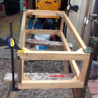 The frame work for a two seater ottoman.