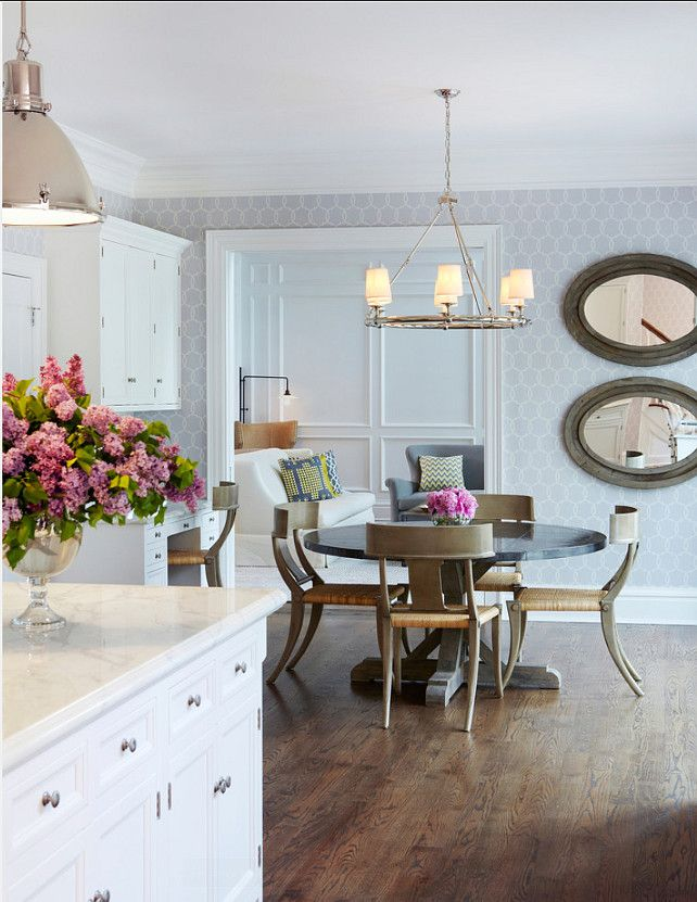 """Kitchen Lighting Ideas. Pendant Ligthing above island are by Ralph Lauren. Chandelier lighting above table is from William-Sonoma Home. Wallpaper is the """"Schumacher Tracery Wisteria Wallpaper"""". #Kitchen #Lighting"""