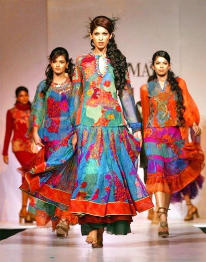 "Not all Indian clothes are saris. Love the silhouettes & bold colors...Design by Ritu Kumar. #3 on my list of ""5 Pieces From India"""