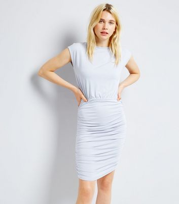 "Opt for pastel tones with this baby blue bodycon dress. Pair with white trainers to keep it casual.- Rounded neckline- Cap sleeves- Ruched sides- Midi length- Bodycon for the closest cut fit- Jana is 5'9""/175cm and wears UK 10/EU 38/US 6"