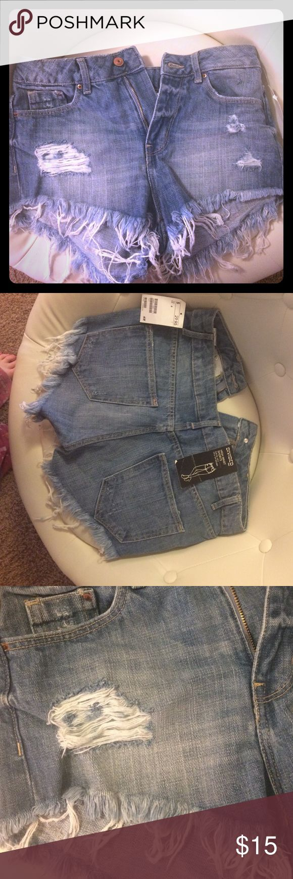 H & M high waist shorts H & M high waisted denim shorts with fraying at bottom& torn look in front, new with tags, size 6 Shorts Jean Shorts