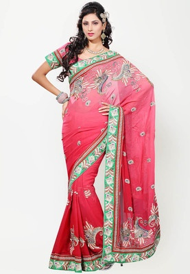 Peach coloured saree for women from Adaa and its made from viscose, This peach coloured saree from Adaa will serve you well for that upcoming special occasion. The extraordinary thread embroidery all over and on the borders combine to create this couture piece that will surely set you apart from the rest.
