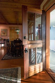 Love the wood and paned glass on this Dutch door. By Real Carriage Door Company