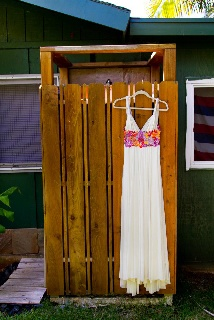 Gorgeous custom designed Hawaiian wedding dress!  A. Ell Design offers beautiful island wedding dresses and wedding attire for the entire wedding party custom tailored for the perfect fit for the perfect day! A. Ell Design:  http://www.islandhempclothing.com/  Photo by: Sanderl Photography: http://sanderl.com/