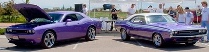 Plum Crazy Dodge Challengers, I will take both please.  The new Challenger is my favorite of the new 'old school' look muscle cars.