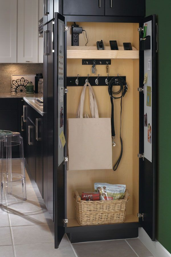 What a great idea for the end of a refrigerator! A drop zone cabinet @masterbrandinc