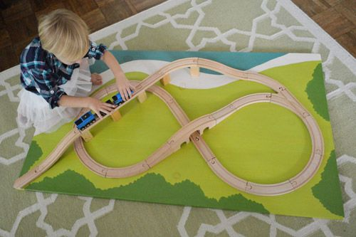 DIY Train Board by Young House Love. This is awesome and I loved these as a kid. I'll have to remember it for our first child.