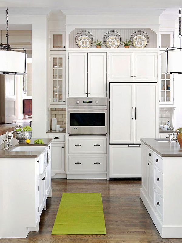 10 Ideas for Decorating Above Kitchen Cabinets | Not sure what to do with that awkward space above your kitchen cabinets? Check out these 10 stylish solutions for decorating above kitchen cabinets. | DecoratingFiles.com | #interiordesign #decoratingabovecabinets #kitchens