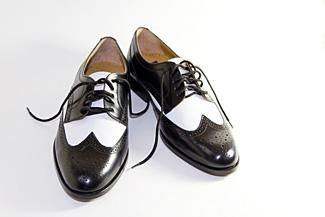 Black and white wing tip shoes