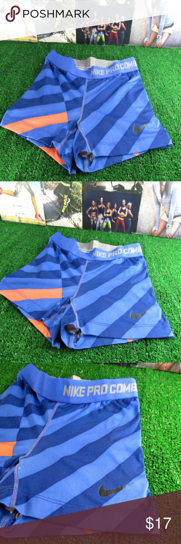 "Nike Dri-Fit Compression Shorts Super comfy Nike Dri-Fit compression shorts. Perfect for hitting the gym or a workout outside. Royal Blue & Darker Blue shaded stripes pattern throughout. Peachy Orange designs with ""Nike Pro Combat"" across the waist band. In overall great pre-loved condition. Size Small.  **Item ships same day if ordered by 4:00 P. M. Central Daylight Time. All orders placed after business hours are shipped the next day.** Made in the USA Shorts"