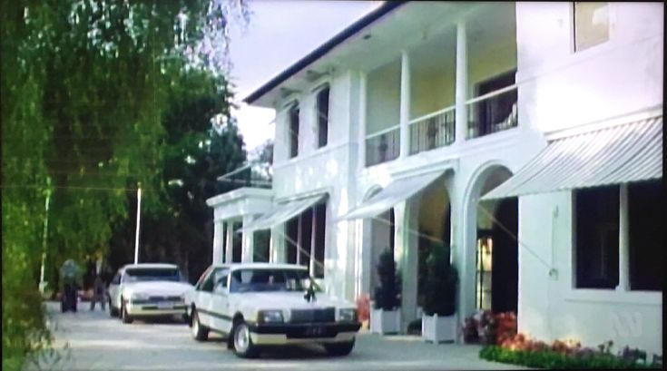 Cars and security detail outside the Lodge, 1985.