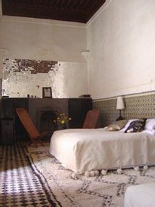 Beni Ourain rug in a rustic bedroom