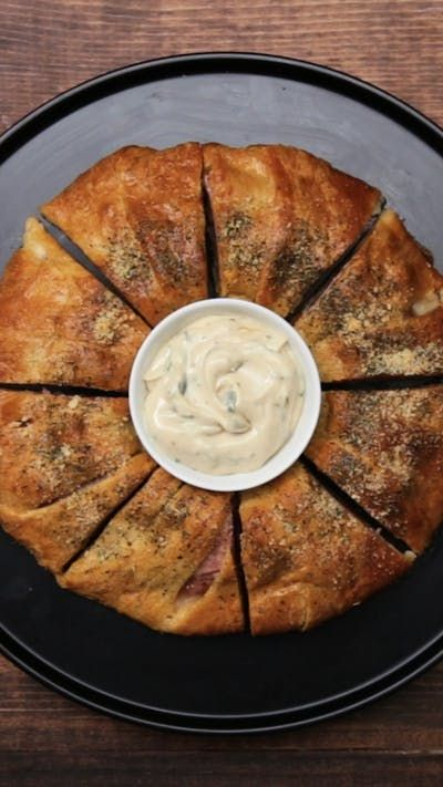 Recipe with video instructions: Made with hot peppers like Thai chili and jalapeño, this pizza roll requires a glass of milk on hand. Ingredients: 2 packages of crescent rolls, 1/2 cup spicy giardiniera, chopped, 10 slices provolone cheese, sliced in half, 10 slices cracked pepper turkey, 10 slices spicy salami, 10 slices mortadella or bologna, 10 slices spicy capocollo, 10 slices ham, Assorted peppers: slices of 1 jalapeño, 1 Fresno, 1 habanero, 1 mini bell pepper, 1 banana pepper, 1 se...