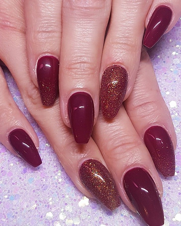 Red burgundy sculpted gel nails with glitter