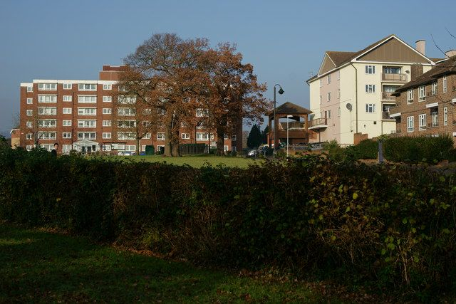 Merstham, Surrey  Looking towards Portland Drive, across a small 'village' green. 2013