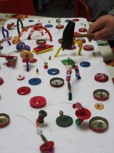 styrofoam, buttons and stuff and hammers...fun! excellent eye-hand coordination activity.