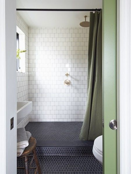 if we don't want to make the whole half side of the bathroom a wet room, we could do a step over like this .  add a bench on the left and hang a floor to ceiling pretty curtain instead of a half glass wall