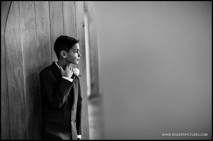 Young Groomsman ready for the ceremony at Rivervale Barn in Hampshire - http://www.rogerspictures.com/rivervale-barn-wedding-photography
