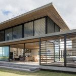 Light woods keep this home on the beach calm and serene