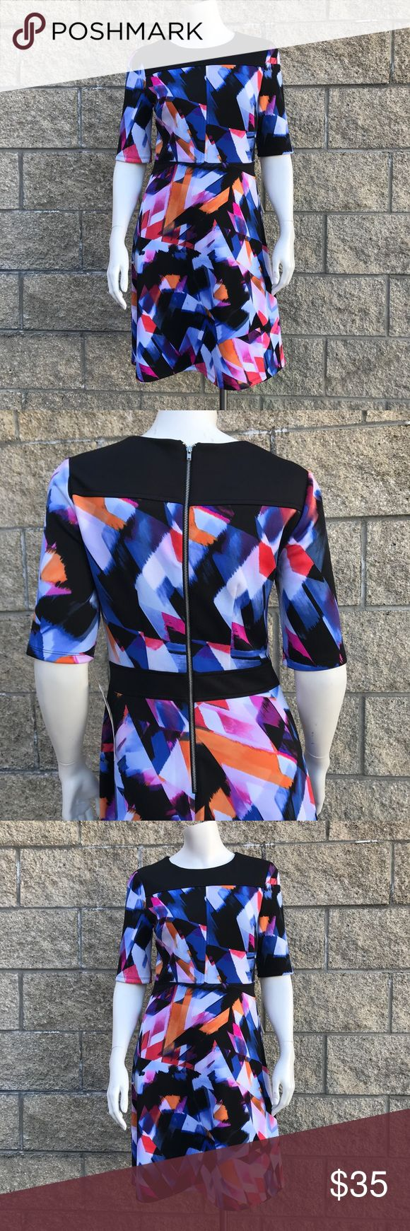 """Maggy L Abstract Skater Dress Maggy L multi colors abstract print, back zipped, stretch, short sleeve, this dress sits just above the knee length. 94% polyester, 6% spandex. 16 1/2"""" chest, 35"""" waist, 35 1/2"""" length. Maggy L Dresses Midi"""