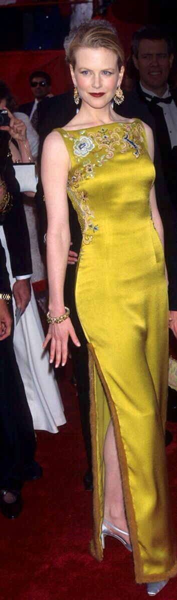 Nicole Kidman on the night she became a fashion icon; wearing a gown by John Galliano for Christian Dior of chartreuse green silk with embroidery and fur trim.