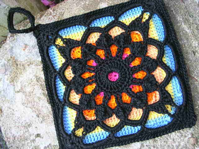 I absolutely love the look of this crochet square! Locutus by Penny Davidson is the crochet piece that is made in black in the featured image.