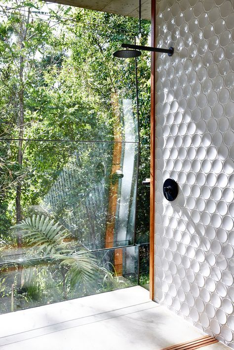 Love the glass and garden. Interesting use of tiles - white texture, wood edge, black tapware. Textured tiles probably not the easiest to clean though.