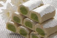 Kaju Pista Roll-Mithai on a roll – or two rolls - one delicious roll inside the other. As someone said, 'nothing succeeds like excess'!
