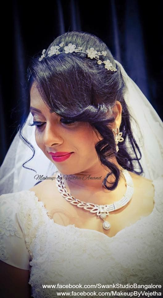 Indian Christian bride's wedding hairstyle by Vejetha for Swank Studio. PHOTO CREDIT: Manish Ananda. Bridal hair. Curls. Hair Accessory. Red lips. Bridal jewellery. Tamil bride. Telugu bride. Kannada bride. Christian bride. Malayalee bride. Find us at https://www.facebook.com/SwankStudioBangalore