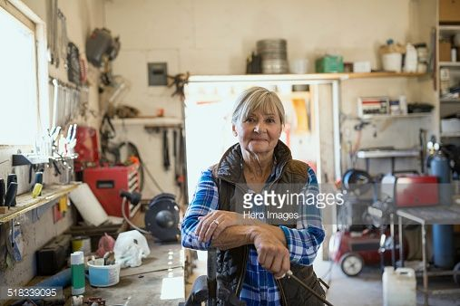 Stock Photo : Portrait of confident woman in workshop