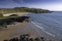 Porth Oer –It's nicknamed Whistling Sands thanks to the peculiar quality of the sand, which squeaks when you stamp on it – so kids absolutely love it.