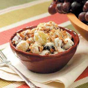 GRAPE SALAD  •1 8oz package cream cheese, softened  •1 cup sour cream  •2 teaspoons vanilla extract  •2 pounds seedless red grapes  •2 pounds seedless green grapes  •3 tablespoons brown sugar  •3 tablespoons chopped pecans  Directions  •In a large bowl, beat the cream cheese, sour cream, and vanilla until blended. Add grapes and toss to coat.   •Transfer to a serving bowl. Cover and refrigerate until serving. Sprinkle with brown sugar and pecans just before serving. Yield: 21-24 servings.